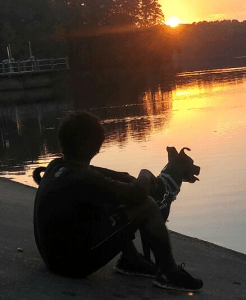 Man and dog at lake